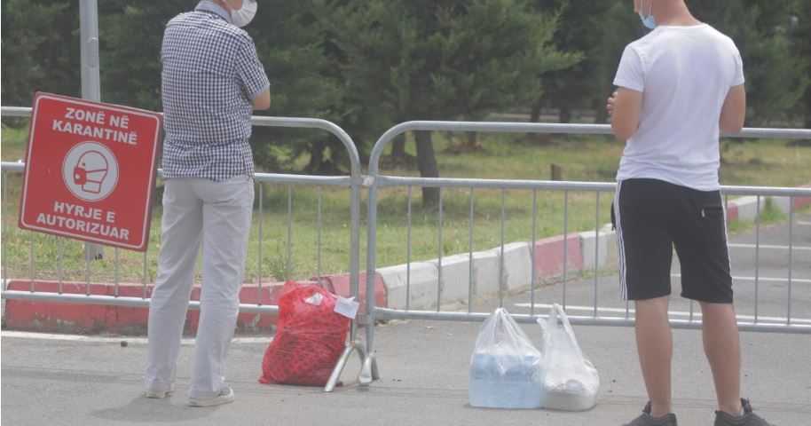Relatives of the infected in Albania, outside the hospital doors with bags of clothes and food